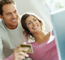 image of couple using credit card